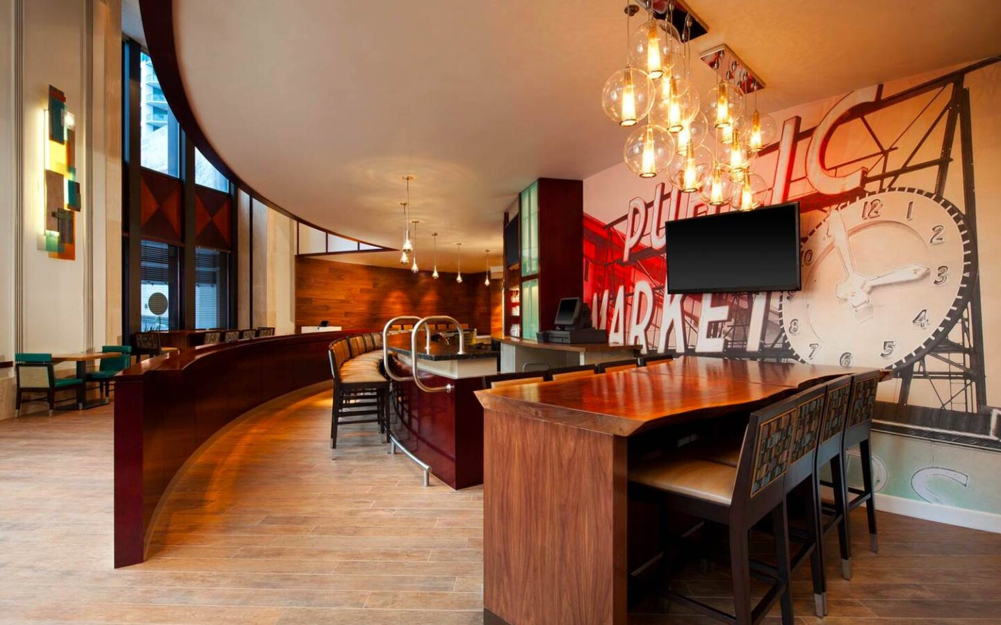 wooden bar area with modern artwork on the wall and circular light fixtures